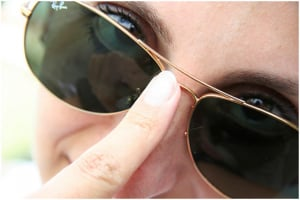 Lady Wearing Ray-Ban Aviators for How to spot fake Ray-Ban Guide.