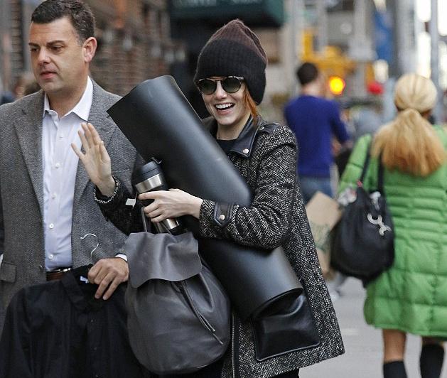 Emma Stone wears retro round style sunglasses
