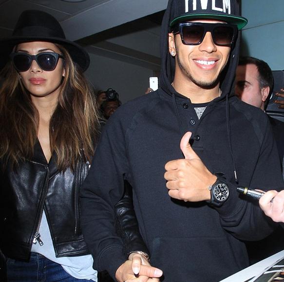 Hamilton wears rectangular sunglasses